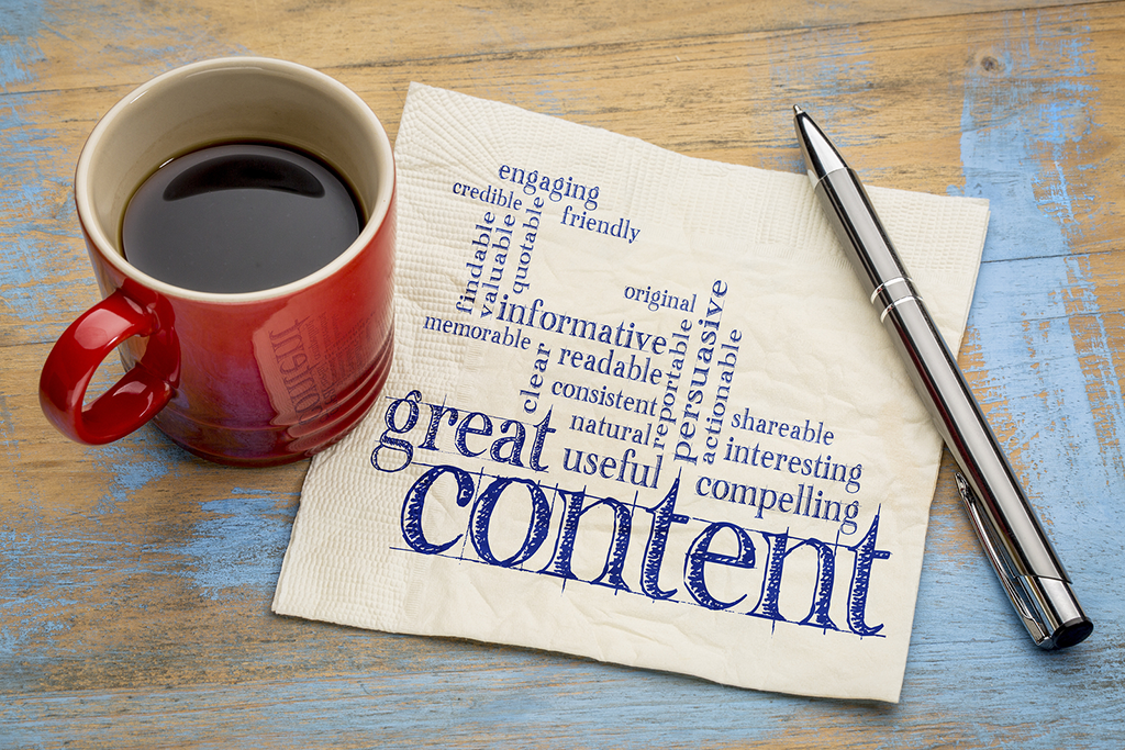 "coffee cup and napkin image with ""great content"" written on the napkin"
