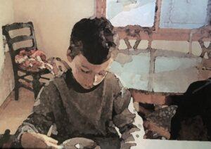 Child at counter looking down at a bowl