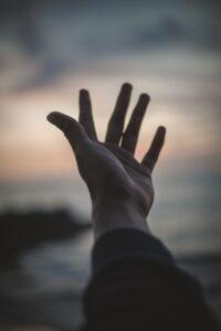 Left hand reaching toward the sky